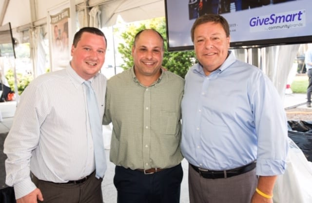 State Senator Patrick M. O'Connor, Father Bill's & MainSpring President & CEO John Yazwinski, and Quincy Mayor Thomas Koch pictured at Father Bill's & MainSpring's 25th annual FoodFest fundraiser, held on Tuesday, July 30 at The Launch at Hingham Shipyard and Hingham Beer Works.