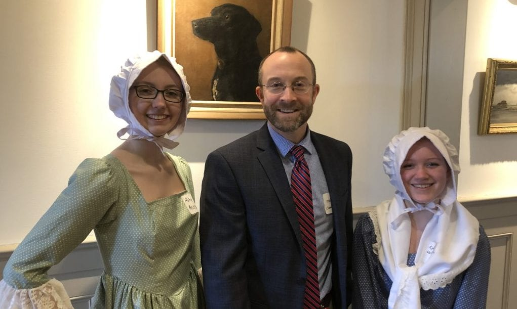 "HHS juniors Abby Meissner (left) and Sydney Collins (right) with HPS Director of Social Studies Andy Hoey after finishing their National History Day performance, ""Ode to Phyllis Wheatley."""