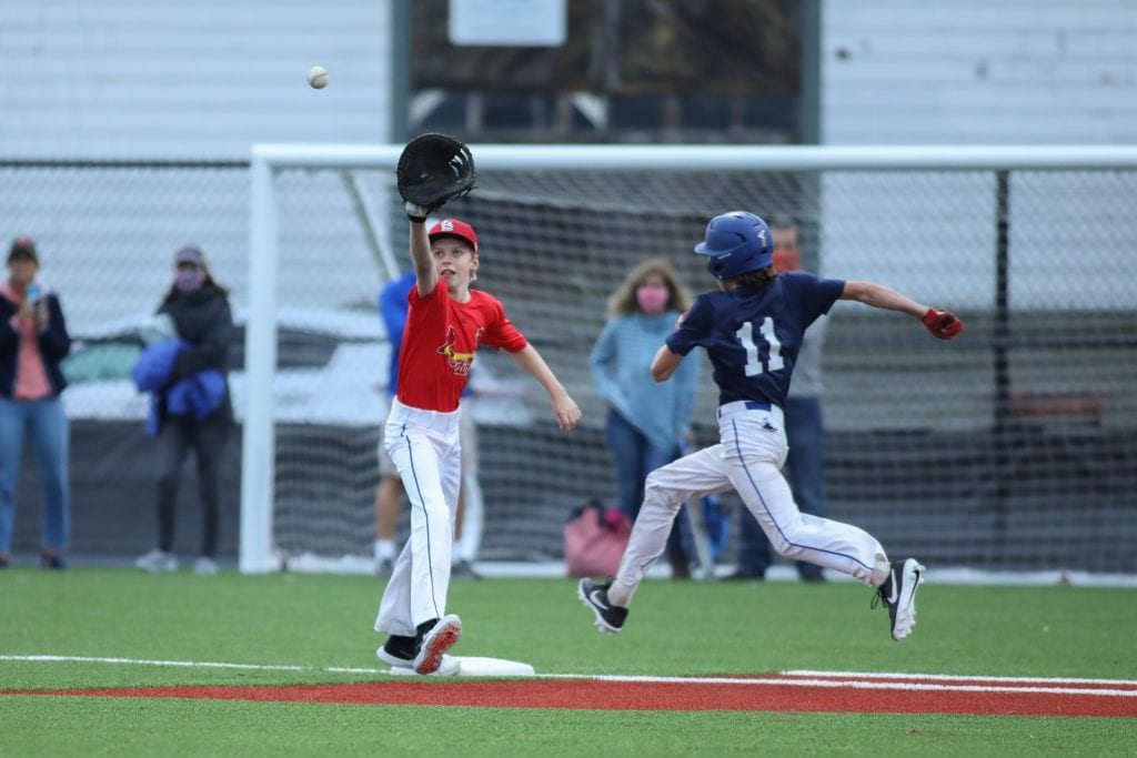 Yankees' Griffin Coppola almost beats the throw to Cardinals' 1st baseman Eric Byrne.