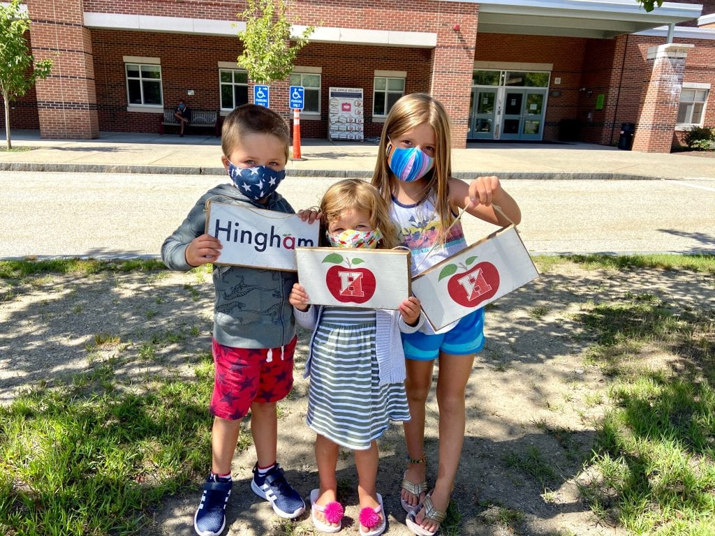 Ryder, Avery and Emily Cormier support the Apple Project (photo by Joshua Ross)
