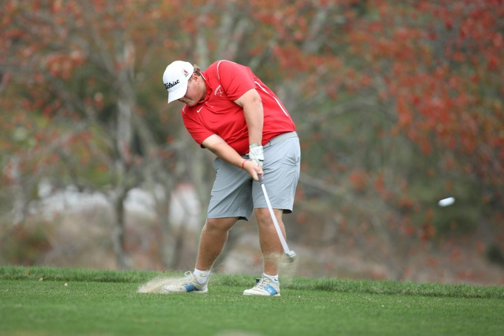 Jake WIlson tees off on the Par 3 second hole during his match with Silver Lake.