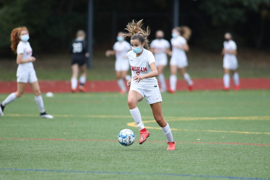Sophomore defender Maddie Aughe brings the ball up the field in the the first quarter.