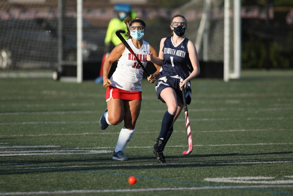 Senior Coco Hernberg chases a loose ball down the sidelines in the 4th quarter.
