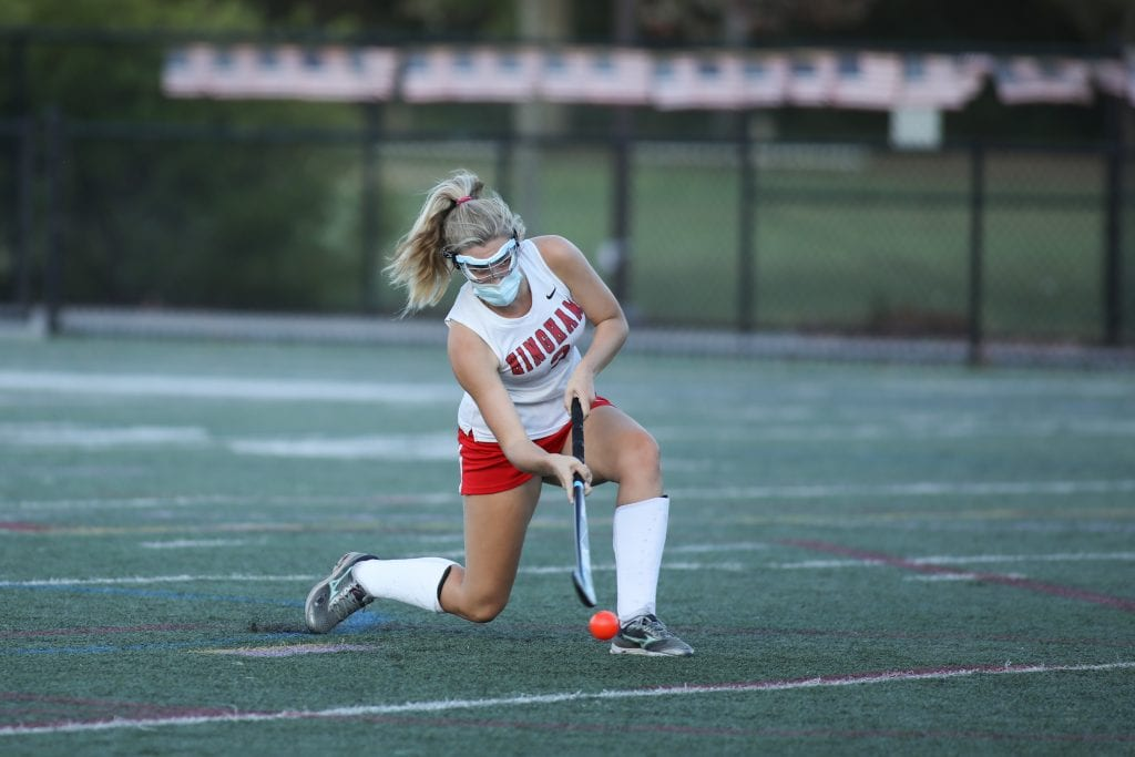 Senior Katie Hartnett scores on a penalty shot in the 4th quarter.