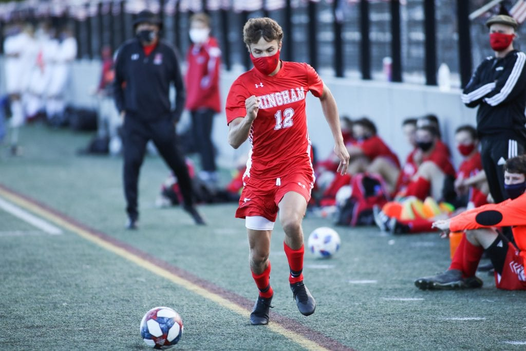 Junior John Sula races down the sideline at the Harbormen keep the pressure on late in the game.
