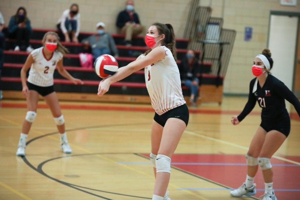 Junior Caroline Connelly sets the ball during the final set of the match.
