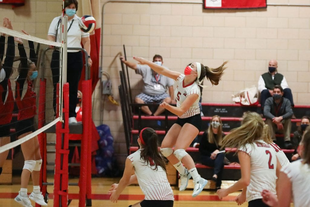Senior Louise Kenny with the kill for the Harbormen against Whitman-Hanson.