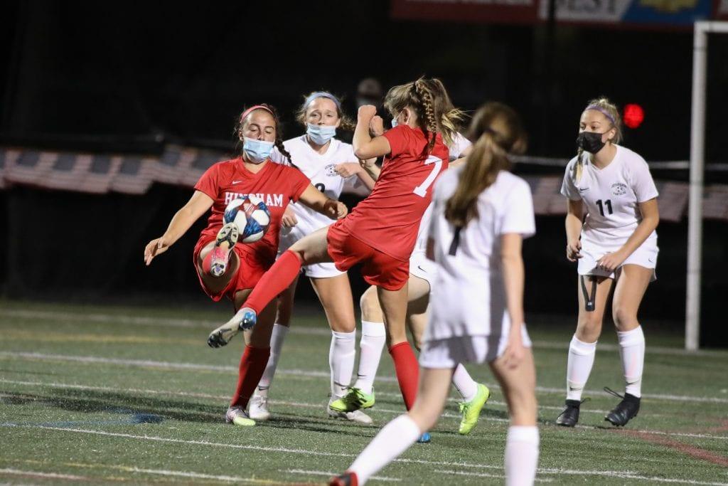 Junior Olivia Sharkansky battles for the position and the ball near WH's goal.
