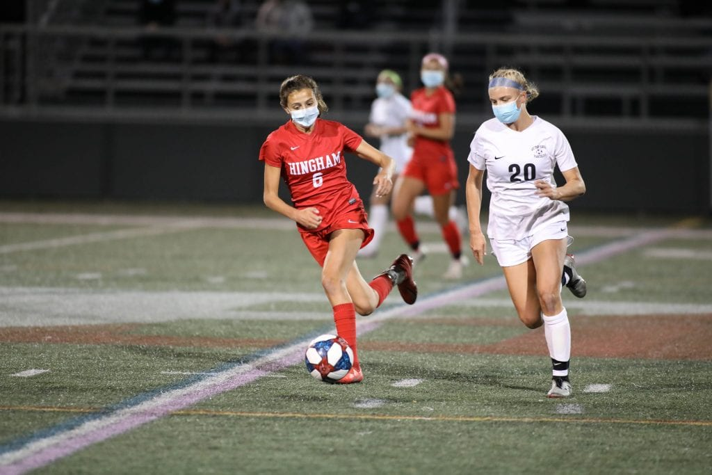 Sophomore defender Maddie Aughe chases down a WH player in the first half.