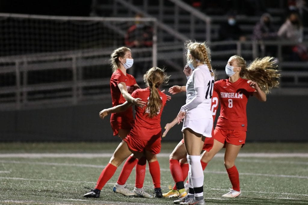 Sophomore Emily Gibbons celebrates with her teammates after her goal gives Hingham the 2-1 lead.