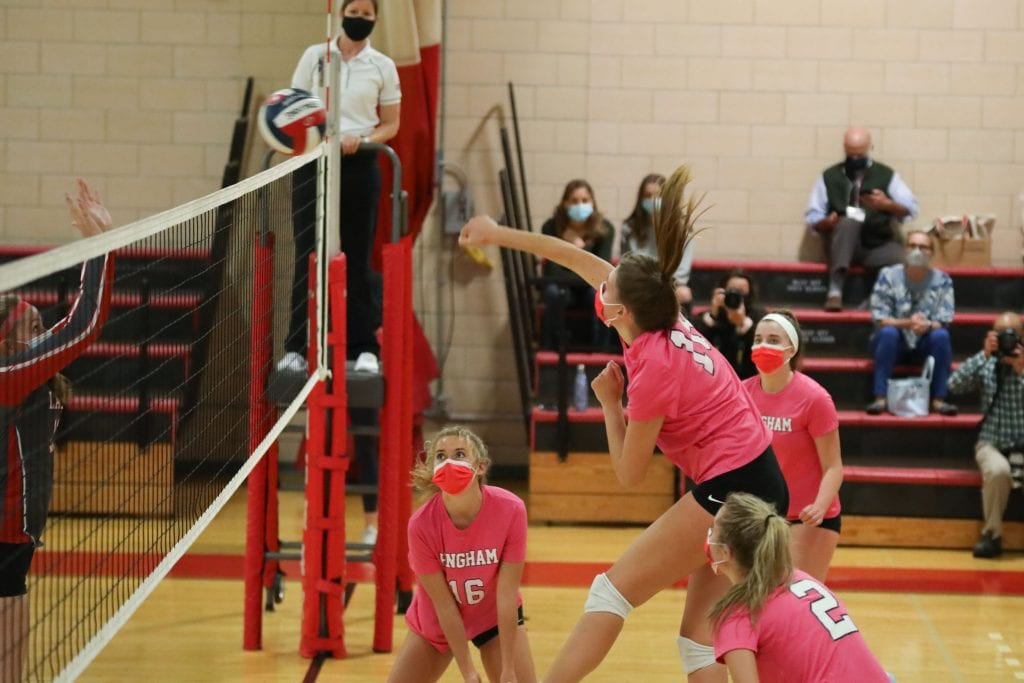 Junior Lilly Steiner spikes the ball for a kill.