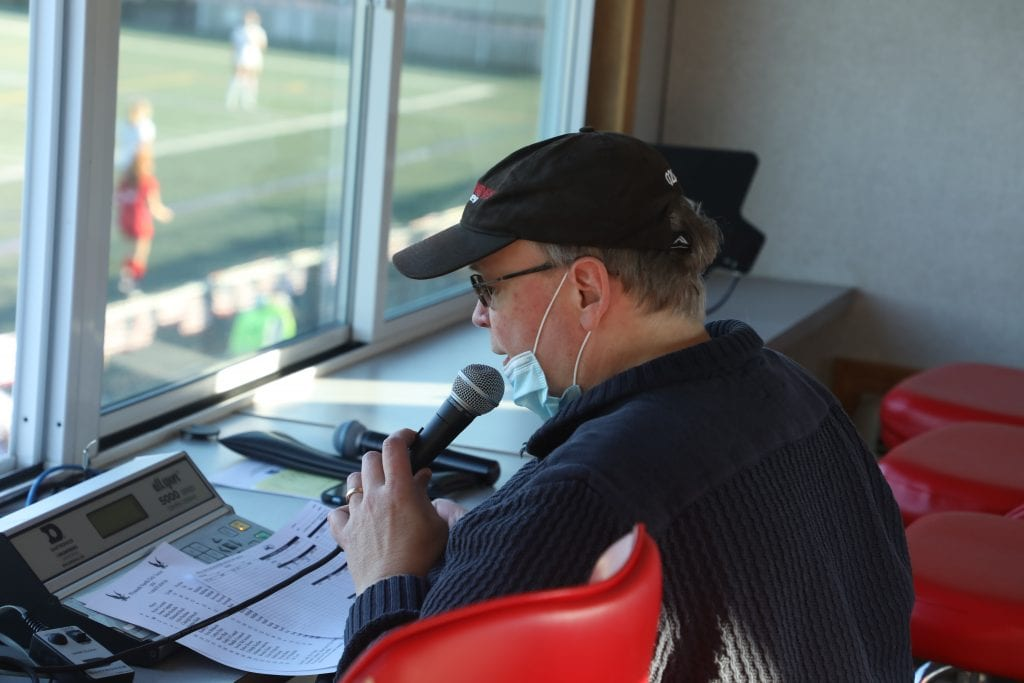 Hingham High School's public address announcer calling a game this year for girls soccer.