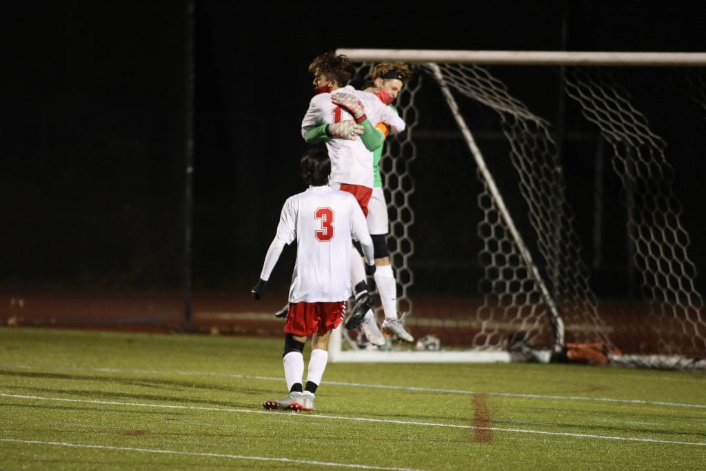 Senior captain and goalie Trent Hesselman celebrates their win and trip to the Patriot Cup Finals.