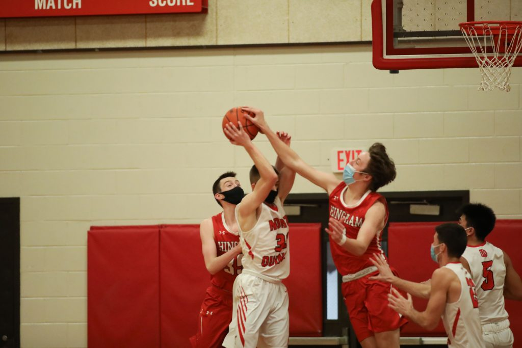 Junior Nick Johannes blocks a shot early in the game.