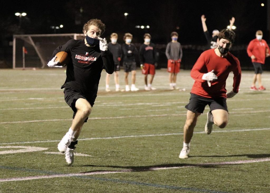 Cooper Estes running down the sideline during the Harbormen's 7v7 showcase.