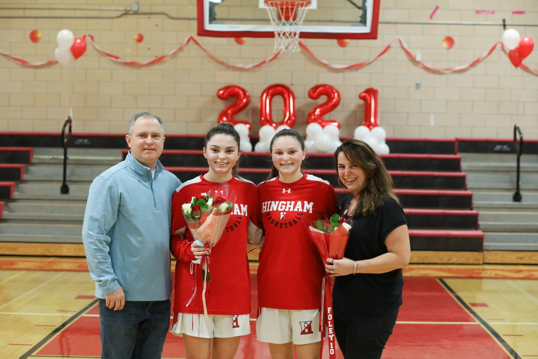 Senior captain Abbey Foley, with her parents Sue and Mike and sister Katie, was honored before the game.