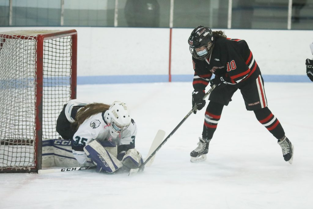 Junior Lilly Thrun tries to stuff it past the goalie.