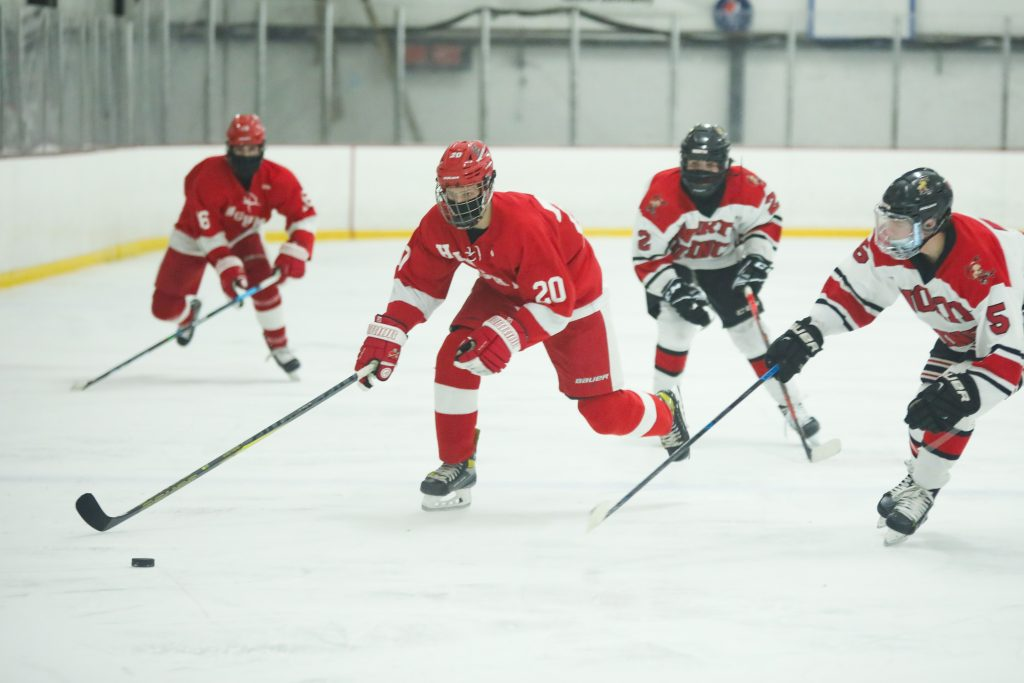 Sophomore Allu Linna carries the puck over the blue line.