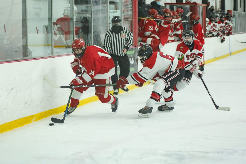 Sophomore Billy Jacobus skates past a defender forcing a tripping penalty.