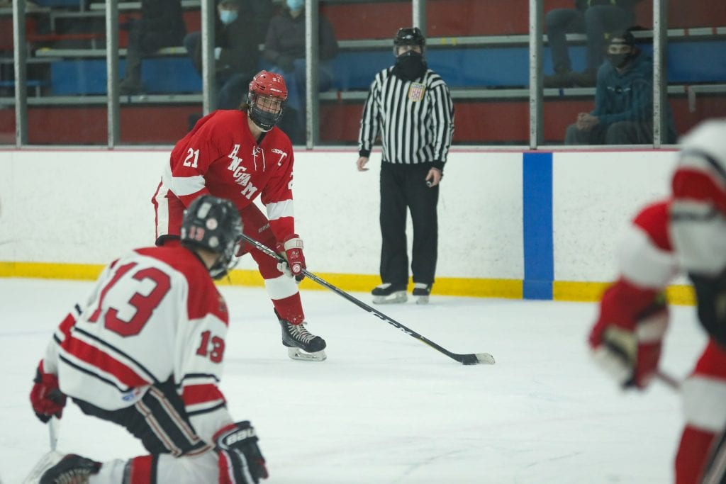 Senior captain Paul Forbes surveys the ice on a Hingham powerplay in the second period.