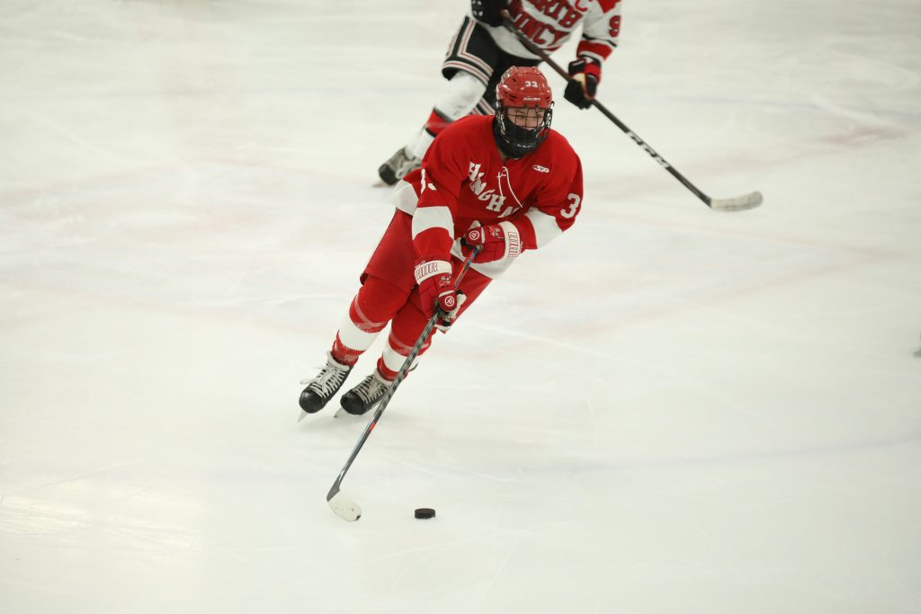 Junior Alex Barzowskas carries the puck into North Quincy's end.