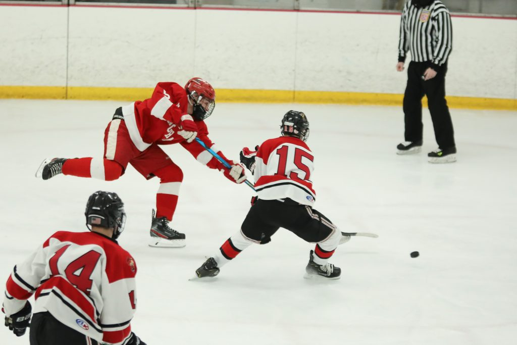 Junior Ryan Burns trying to add to the Harbormen's lead in the third.