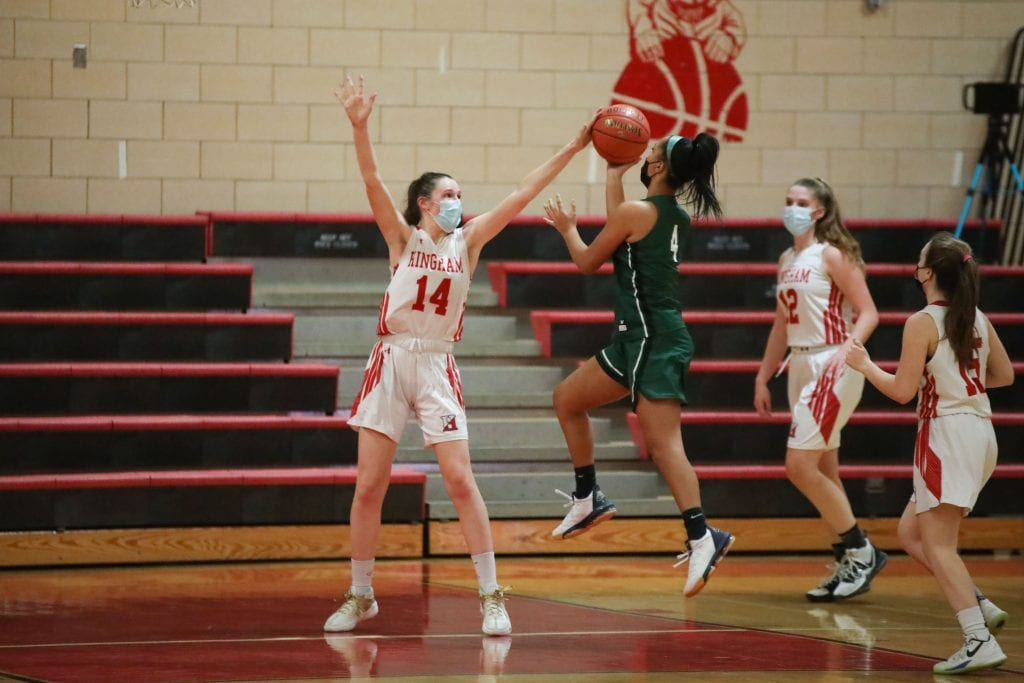 Junior captain Caroline Connelly blocks Duxbury's Laurene Jordan in the 4th quarter.