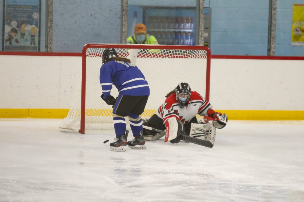 Junior Amy Maffei makes the save of the game on a penalty shot in the third period.