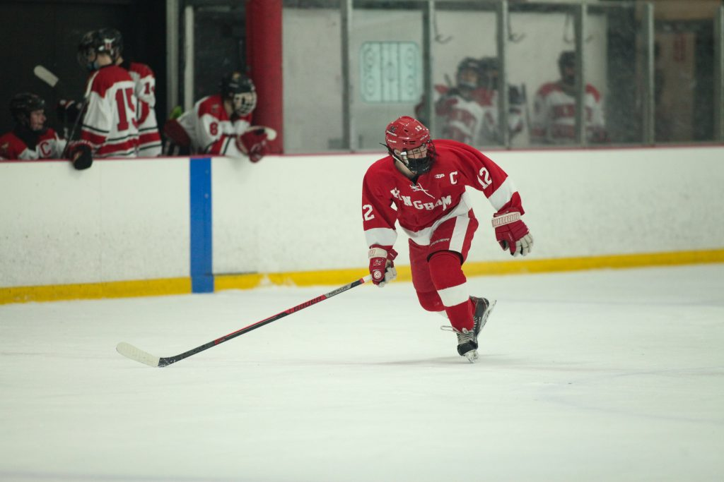 Senior captain Tommy McNally racing down the ice to defend his zone.
