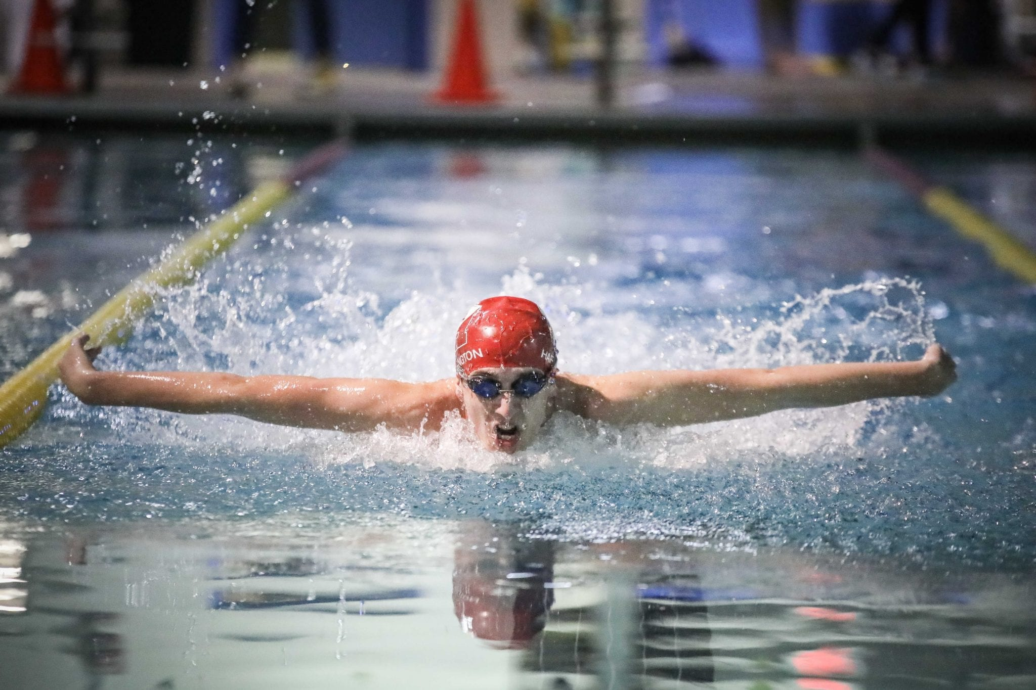 Senior captain PJ Harrington competes in the 100m butterfly during a virtual meet.