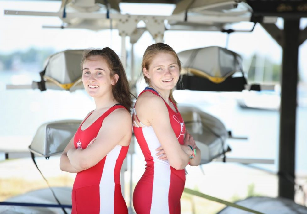 Devon Moriarty (left) and Ella Niehoff rowed continuous on erg machines for 34 hours. (Photo by Joshua Ross Photography)