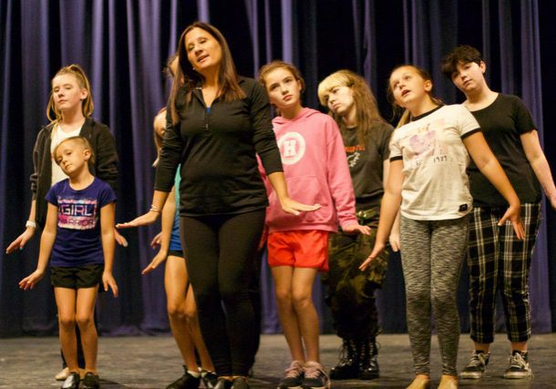 """""""Seussical The Musical"""" choreographer Liz Tronni, of Hingham, rehearses ensemble members for the song """"Here on Who."""" (Photo by Kerry Tondorf)"""